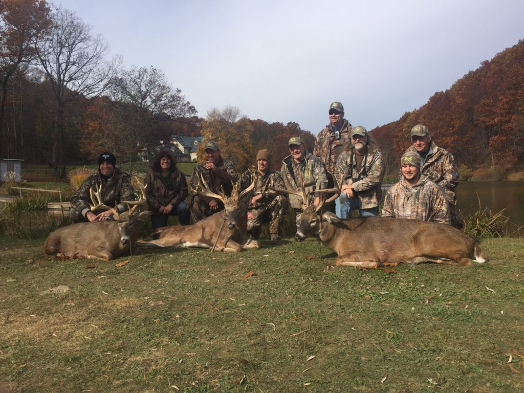 Veterans posing with deer after a hunt